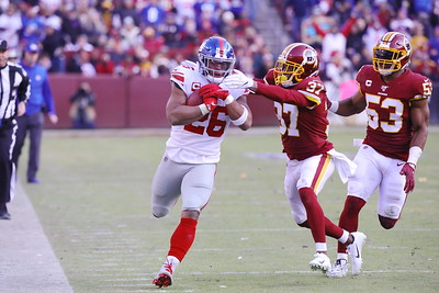 George P. Smith/The Montgomery Sentinel    Redskin's Coty Sensabaugh (37) and Jon Bostic (53) come up to drive Giants' Saiquon Barkley (26) out of bounds.