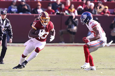 George P. Smith/The Montgomery Sentinel    Redskins' Kevin Harmon (13) looks at Giants' Sam Beal (23) after making a catch.