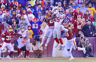 George P. Smith/The Montgomery Sentinel    Redskins' Landon Collins (20) would make sure Giants' Golden Tate (15) would not hold on to this catch with 2 seconds left in regulation. The Giants went on to win in overtime.
