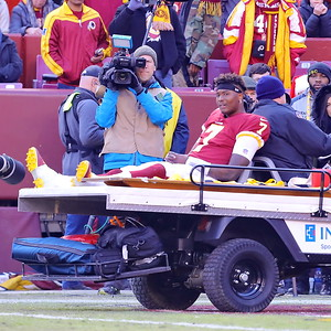 George P. Smith/The Montgomery Sentinel    Redskins' Dwayne Haskins (7) leaves the field on a cart after injuring his ankle when he was sacked.