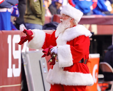George P. Smith/The Montgomery Sentinel    Santa arrived early at FedEx Field with T-shirts for lucky boys and girls.