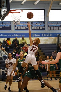George P. Smith/The Montgomery Sentinel    Takoma Academy's Jade Berryman (12) with the left handed layup.