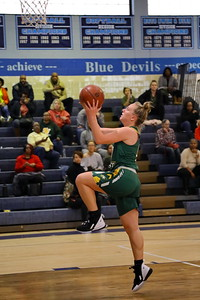 George P. Smith/The Montgomery Sentinel    Seneca Valley's Hannah Himes (13) finishes a fast break.