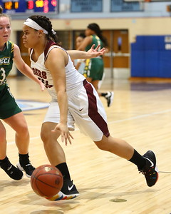 George P. Smith/The Montgomery Sentinel    Tacoma Academy's Delia Allen (32) drives on Seneca Valley's Hannah Himes (13).