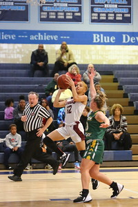 George P. Smith/The Montgomery Sentinel    Takoma Academy's Jade Berryman (12) taking it to the hoop past Seneca Valley's Hannah Himes (13).