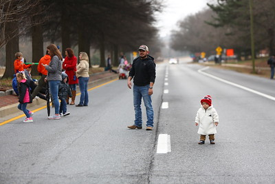 George P. Smith/The Montgomery Sentinel    Football fans play catch on the  closed Roscoe Rowe Boulevard waiting for the 2019 Military Bowl parade.