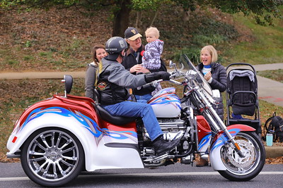 George P. Smith/The Montgomery Sentinel    Little 15 month old Jack Kavanek seemed enamored with the big boy tricycle as he took in the 2019 Military Bowl Parade with grandma and grandpa.