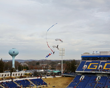 George P. Smith/The Montgomery Sentinel    Parachutists bank sharply to line up for final approach to the Navy-Marine Corps Stadium before the 2019 Military Bowl game.