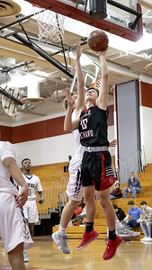 December 27, 2019 - In a game dominated by Quince Orchard fast breaks, Cole Allemong gets the bucket against the Urbana Hawks in the 73-49 QO win at home. Photo by Mike Clark/The Montgomery Sentinel