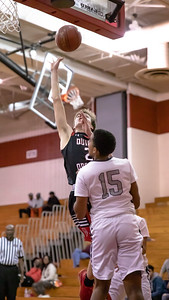 December 27, 2019 - Quince Orchard Captain Teddy Kelly drives past Urbana''s Gabe Bonny for two of his seven points in the lop-sided 73-49 David Griffin Invitational Tournament December 27th at Quince Orchard High School. Photo by Mike Clark/The Montgomery Sentinel