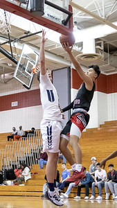 December 27, 2019 - In one of the few denials of the baseline, Urbana's Justin Zimmerman stops Quince Orchard's Drew Heinrichs' drive to the basket. Photo by Mike Clark/The Montgomery Sentinel