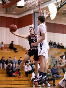 December 27, 2019 - Despite the height advantage of Urbana's Justin Zimmerman, Quince Orchard Guard Teddy kelly gets this layup to fall in the 73-49 domination on December 27th at host Quince Orchard. Photo by Mike Clark/The Montgomery Sentinel