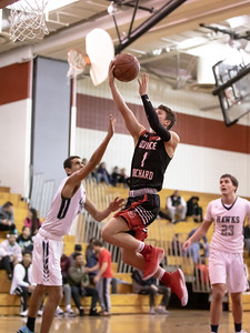 December 27, 2019 - Alex Parisotto of the Quince Orchard Cougars lays in two of his 20 points in the 73-49 win over Urbana. QO dominated the December 27th game, part of the weekend David Griffin Tournament hosted by Quince Orchard. Photo by Mike Clark/The Montgomery Sentinel