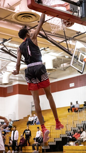December 27, 2019 - Jeremaih Littlejohn brought the Quince Orchard crowd to their feet with this second-half dunk in the 73-49 win over Urbana on December 27th at home. Photo by Mike Clark/The Montgomery Sentinel
