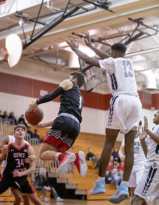 December 27, 2019 - Alex Parisotto of the Quince Orchard Cougars hangs in the air on this drive for two of his 20 points in the 73-49 win over Urbana in the December 27th David Griffin Tournament game at host Quince Orchard. Photo by Mike Clark/The Montgomery Sentinel