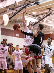 December 27, 2019 - Despite the tough defense by Urbana's Justin Zimmerman (23), Quince Orchard's Alex Parisotto (1) finds a way to score two more of his game-high 20 points in the 73-49 win at home. Photo by Mike Clark/The Montgomery Sentinel