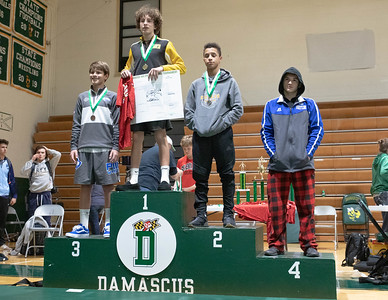 December 28, 2019 - Enzo Bell of Bullis takes second place in the 106-lb. weight class of the Damascus Holiday Tournament - losing 4-12 to South Carroll's Michael Pizzuto. Photo by Mike Clark/The Montgomery Sentinel