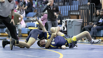 January 4, 2020 - Meyer Shapiro of Bullis gets the pin on BCC's Lance Lorenzo in the 132 lb. weight class during the BCC vs Bullis duals match on January 4th. Photo by Mike Clark/The Montgomery Sentinel