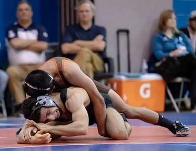 January 4. 2020 - The 2018 state champion Lorenzo Lopez of Landon gets an advantage on the 2019 2nd ranked in the state Siavash Sarvestani of Northwest in the 2020 Barrons Duals at Bethesda-Chevy Chase. Lopez won 7-2 and took Outstanding Wrestler in the tournament. Photo by Mike Clark/The Montgomery Sentinel