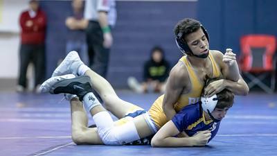 January 4, 2020 - Enzo Bell of Bullis handles Sam Moffit of BCC with a pin at 2:32 in the 106 lb. weight class during the BCC vs Bullis duals match at the Battlin Barons Duals meet on January 4th. Photo by Mike Clark/The Montgomery Sentinel