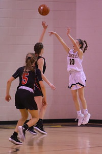 George P. Smith/The Montgomery Sentinel    Richard Montgomery's Callie Dunn (10) shoots from beyond the arc.