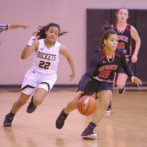 George P. Smith/The Montgomery Sentinel    Quince Orchard's Makayla Wright (10) starts the transition as Richard Montgomery's Gloria Moudou (22) gives chase.