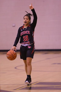 George P. Smith/The Montgomery Sentinel    Quince Orchard's Makayla Wright (10) runs the floor for the Lady Cougars.