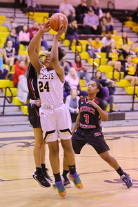 George P. Smith/The Montgomery Sentinel    Richard Montgomery's Taheerah Rashad (24) takig it to the hoop.