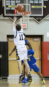 January 10, 2020 - Hayden Lunenfeld of Richard Montgomery drains three consecutive three-pointers and 15 total points to help squeeze out a one-point victory over Gaithersburg, who erased a double-digit defecit and missed a game-winning attempt at the buzzer at Richard Montgomery on January 10th. Photo by Mike Clark/The Montgomery Sentinel
