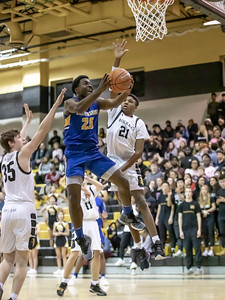 January 10, 2020 - Gaithersburg's Jao Ituka flies in for two of his 17 points but missed a tough shot at the buzzer as Richard Montgomery won 74-73 on January 10th at home. Photo by Mike Clark/The Montgomery Sentinel