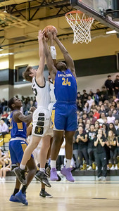 January 10, 2020 - Richard Montgomery's Alex Meringoff battles Gaithersburg's Chris Kouemi for this rebound during the Gaithersburg failed comeback attempt from 10 points down. Richard Montgomery won 74-73 at home on January 10th. Photo by Mike Clark/The Montgomery Sentinel