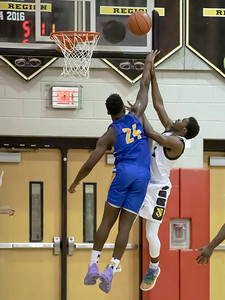 January 10, 2020 - Gaithersburg's Chris Kouemi gets the block but fouls Kordell Lewis of Richard Montgomery, Lewis finished with 10 points in the thrilling 74-73 Richard Montgomery win on January 10th at home. Photo by Mike Clark/The Montgomery Sentinel