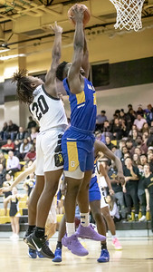 January 10, 2020 - Richard Montgomery's Shaq Samuels gets the block on Gaithersburg's Chris Kouemi from behind during the 74-73 Richard Montgomery win at home on January 10th. Photo by Mike Clark/The Montgomery Sentinel