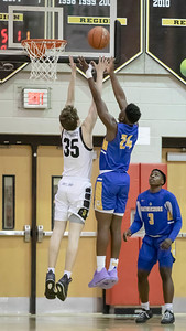 January 10, 2020 -Richard Montgomery's Alex  Meringoff (35) battles Gaithersburg's Chris Kouemi for the rebound in a 74-73 4A West thriller at Richard Montgomery. Photo by Mike Clark/The Montgomery Sentinel