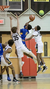 January 10, 2020 - The smothering Richard Montgomery defense shut down Gaithersburg early, which led to a double-digit lead until the fourth quarter run by Gaitnersburg. Richard Montgomery held on for the 74-73 win at home on January 10th. Photo by Mike Clark/The Montgomery Sentinel