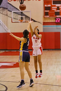 George P. Smith/The Montgomery Sentinel    Montgomery Blair freshman Natalie Frost (11) shoots from beyond the arc over BCC's Jessica Katz (5).