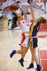 George P. Smith/The Montgomery Sentinel    Montgomery Blair's Emily Liu (12) taking it to the hoop against BCC's Freya Hansen (24).