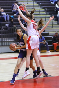 George P. Smith/The Montgomery Sentinel    Bethesda-Chevy Chase's Nora Fairbanks-Lee (25) gets Montgomery Blair's Peyton Martin (10) up in the air and passes around her into the paint.