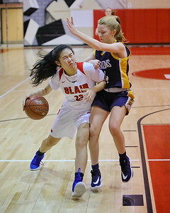 George P. Smith/The Montgomery Sentinel    Montgomery Blair's Emily Liu (12) puts her shoulder down and drives to the hoop through BCC's Freya Hansen (24).