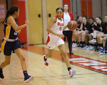 George P. Smith/The Montgomery Sentinel    Montgomery Blair's Natalie Frost (11) brings the ball upcourt under the watchful eye of BCC's Nora Fairbanks (25).