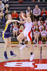 George P. Smith/The Montgomery Sentinel    As the 3rd quarter draws to a close Montgomery Blair's Zo? Abramson launches a half-court shot over Bethesda-Chevy Chase's Emily Niman (12).