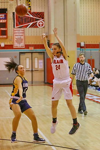 George P. Smith/The Montgomery Sentinel    Montgomery Blair's Amelia Martin (24) launches a shot from outside the 3-point line.