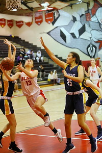 George P. Smith/The Montgomery Sentinel    Montgomery Blair's Kate Hildebrandt (13) splits the BCC defense as she takes it to the hoop.