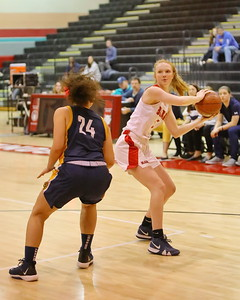 George P. Smith/The Montgomery Sentinel    Montgomery Blair's Lucy Martin (5) looks to feed the ball into the paint past Bethesda-Chevy Chase's Freya Hansen (24).