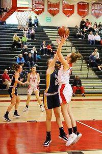 George P. Smith/The Montgomery Sentinel    Montgomery Blair's Peyton Martin (10) shoots over Bethesda-Chevy Chase's Katie Lawson (14).