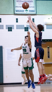 January 13, 2020 - Wootton's Will Margarites drains another three-pointer - part of his 20-point performance that helped Wootton escape Walter Johnson High School with a 64-63 win on January 13th. Photo by Mike Clark/The Montgomery Sentinel