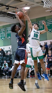 January 13, 2020 - Walter Johnson's Phil Stubin gets the block on the shop attempt by Wootton's Hubert Bayigamba in the exciting last second 64-63 Wooton win at Walter Johnson on January 13th. Photo by Mike Clark/The Montgomery Sentinel
