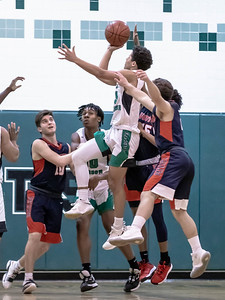 January 13, 2020 - Walter Johnson's Kai Holloway drives through the Wootton defense for two of his 12 points but Wootton takes back the lead for good in the final seconds of the 64-63 game at Walter Johnson on January 13th. Photo by Mike Clark/The Montgomery Sentinel