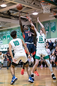 January 13, 2020 - Normand Bayigamba of Wootton muscles in for the shot against Walter Johnson's Patrick Kemp in a thrilling one-point Wooton win at WJ on January 13. Photo by Mike Clark/The Montgomery Sentinel