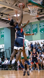 January 13, 2020 - Wootton's Hubert Bayigamba soars in for the basket to help extend the Wootton third quarter lead to double digits. Walter Johnson fought back but lost to Wotton 64-63 at Walter Johnson on January 13th. Photo by Mike Clark/The Montgomery Sentinel